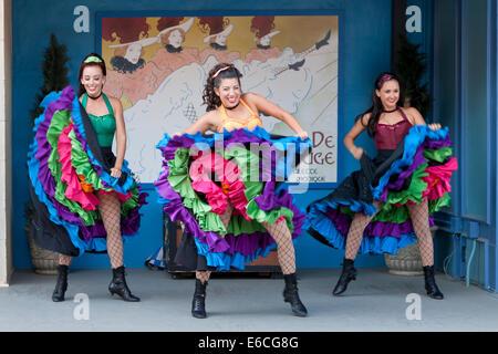 Dancing girls wearing colorful costumes - Stock-Bilder