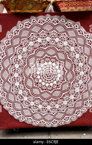 Intricate Round Lace Tablecloth Against A Red Background On The Island Of  Burano In The Venetian
