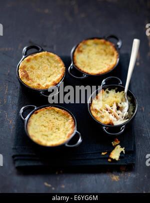 Crab and potato mini casseroles - Stock Image