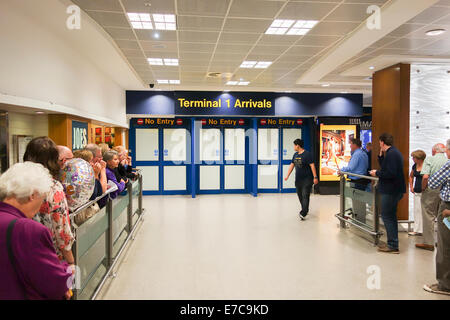 Terminal one passenger arrivals gate at Manchester Airport UK - Stock-Bilder