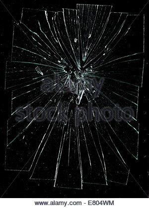 shattered & broken glass against black background - Stock-Bilder