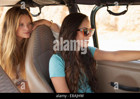 Two young women traveling in car - Stock-Bilder