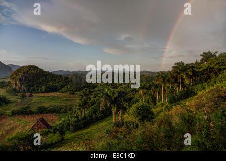 rainbow in the evening landscape of Vinales, Pinar del Rio province, Cuba - Stock Image