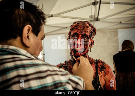 People dressed as zombies participate in the Sitges Zombie Walk 2014 - Stock Image
