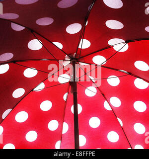 Open umbrella with polka dot pattern - Stock Image