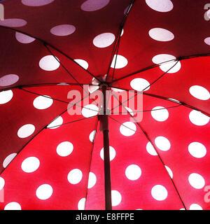 Under open umbrella - Stock Image