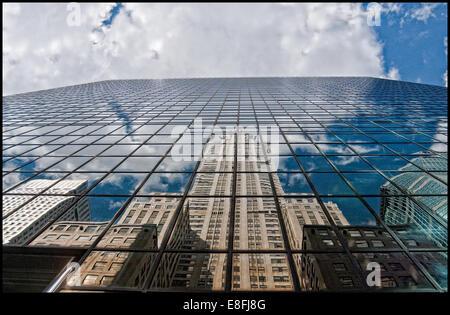 Chrysler building and skyscraper reflections in glass building, New York, america, USA - Stock-Bilder