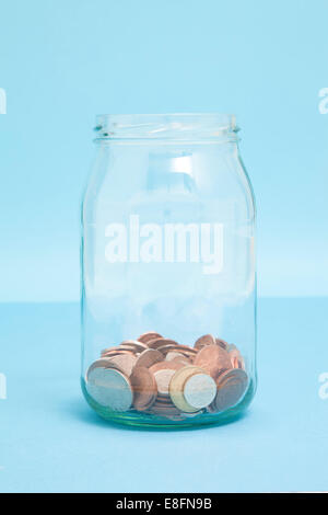 Coins in Jar - Stock Image