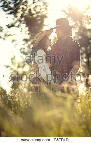 Cowboy and cowgirl couple in field - Stock-Bilder