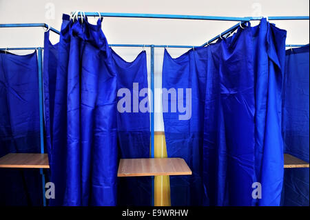 Voting Booths With Blue Drawn Curtains And No People Inside   Stock Image