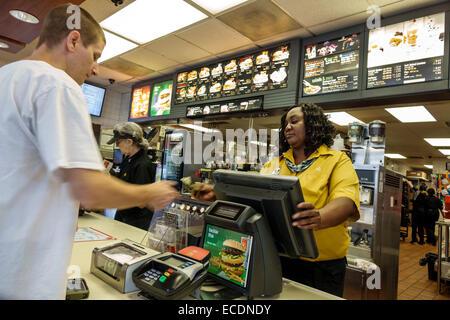 Springfield Illinois McDonald's fast food restaurant counter Black woman employee working manager man customer - Stock Image