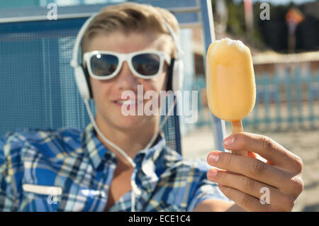 Portrait teenager holiday beach summer ice cream - Stock Image