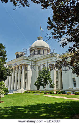 State capital building of Alabama, from the southwest lawn with the U.S. flag and state flag flying. - Stock Image