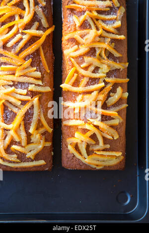 home baked orange cakes on metal tray with home made crystalised orange peel topping - Stock-Bilder