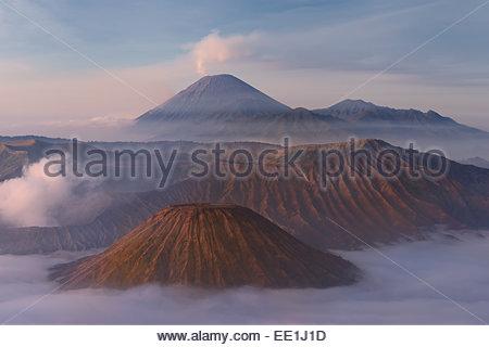 Sunrise over the smoking Gunung Bromo volcano, Bromo-Tengger-Semeru National Park, Java, Indonesia, Southeast Asia, - Stock Image