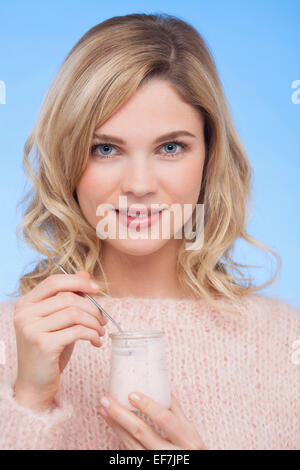 Close-up of a woman eating yogurt - Stock Image