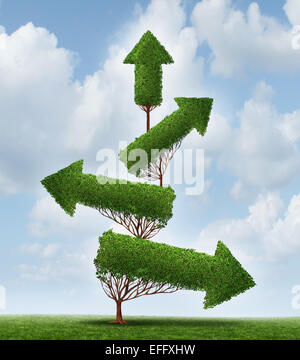 Recovery and success business concept as an arrow tree pointing downward gradually recovering with upward pointing - Stock-Bilder
