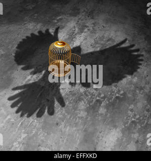 Cage freedom concept as an open birdcage with a giant bird cast shadow flying above with open wings as a symbol - Stock-Bilder