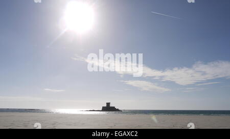 Afternoon sun over Rocco Tower at St Ouens bay, Jersey - Stock-Bilder