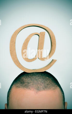 closeup of a young man with an at sign in his head - Stock Image