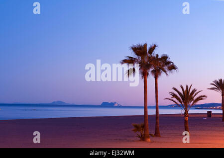 Estepona beach, La Rada, looking out to Gibraltar and Africa on The horizon. Costa del Sol, Malaga Province Spain. - Stock Image