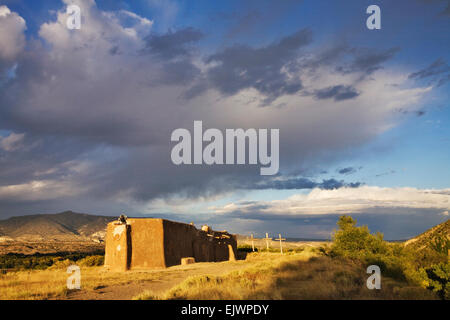 A morada, or Penitente chapel, sits on a hill about the village of Abiquiu, New Mexico. - Stock Image