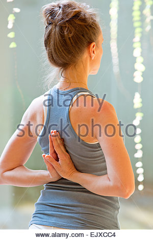 Back View of Woman Practicing Yoga - Stock Image