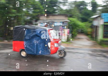 RICKSHAW IN SIGIRIYA DURING MONSOON RAIN STORM - Stock Image