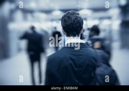 people walking in metro, blurred motion, back of the man - Stock-Bilder
