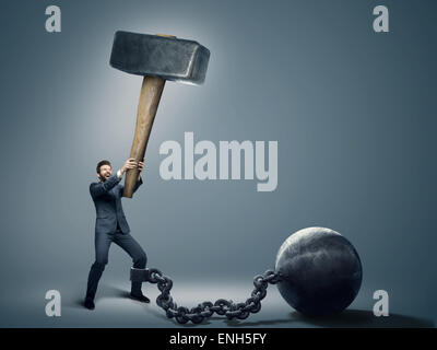 Conceptual image of an employee trying to quit a job - Stock Image