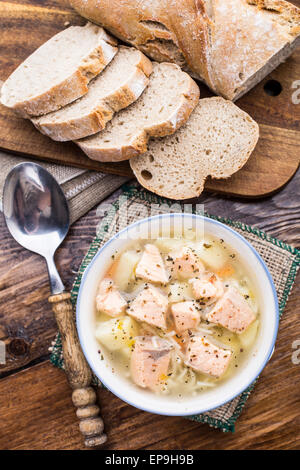 Delicious salmon soup with noodles in a bowl - Stock Image