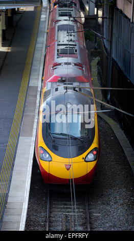 A Class 390 Pendolino train operated by Virgin Trains at Edinburgh's Waverley Station. - Stock Image