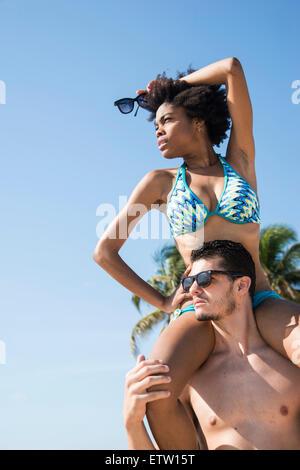 A Latin couple on the beach - Stock Image