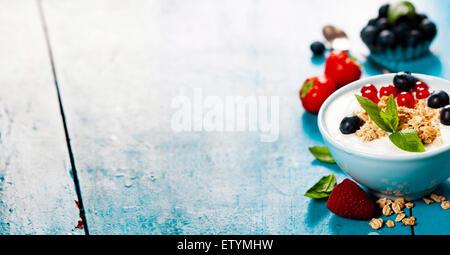 Healthy breakfast - yogurt with muesli and berries - health and diet concept - Stock Image