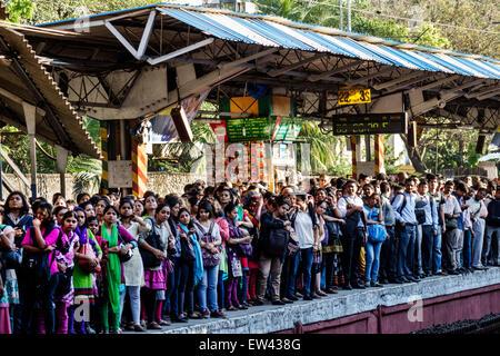 Mumbai India Indian Asian Dadar Railway Station train Western Line public transportation passengers riders standing - Stock Image