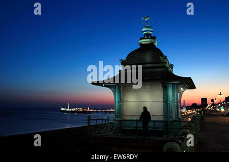 Twilight sky behind the Madeira Lift, Marine Parade, Brighton. Pier lit up in the background. - Stock Image
