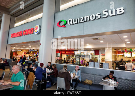 North Carolina Charlotte Charlotte Douglas International Airport inside terminal concourse gate area restaurant - Stock Image