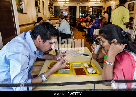 India Indian Asian Mumbai Tardeo Jehangir Boman Behram Road restaurant man woman couple eating inside table - Stock Image