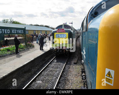 The station porter at Horsted Keynes station on the preserved Bluebell Railway in Sussex hands the Single Line tablet - Stock Image