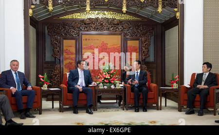 Beijing, China. 8th July, 2015. Chinese Vice Premier Zhang Gaoli (2nd R) meets with Anatoly Kalinin (2nd L), deputy - Stock Image