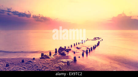 After purple sunset, peaceful sea landscape. - Stock Image
