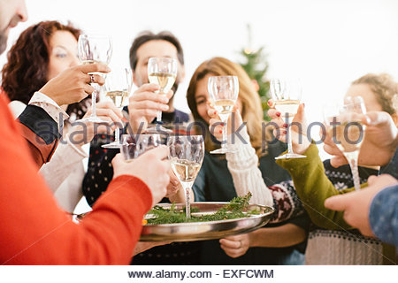 Family toasting at family Christmas party - Stock-Bilder