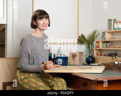 Female artist at work - Stock Image