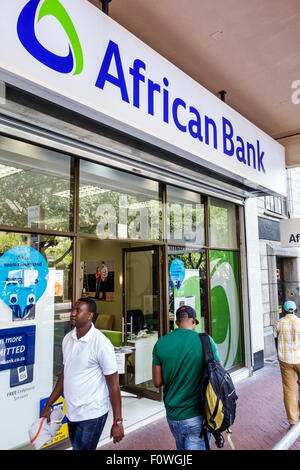 Cape Town South Africa African City Centre center Adderley Street African Bank front entrance Black man pedestrian - Stock Image