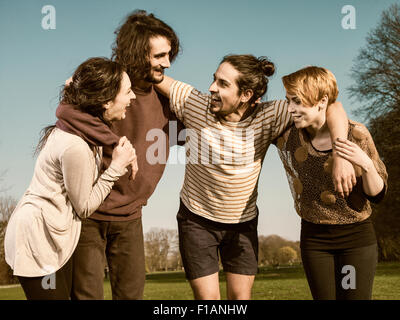 Group of four friends having fun - Stock Image