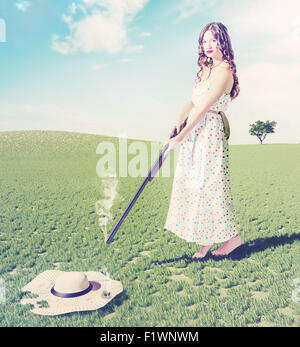 beautiful young girl  shot a flying hat. Creative concept photo and cg elements combinated - Stock-Bilder