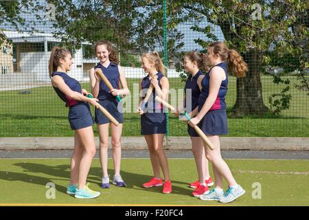 Group of girls with rounders bats - Stock-Bilder