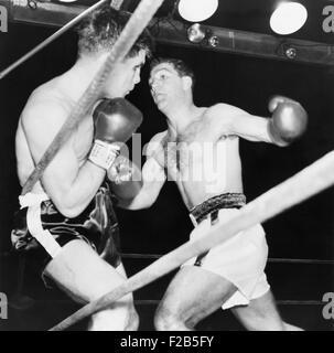 Heavyweight champion Rocky Marciano (right) backs Roland LaStarza against the ropes. Sept. 24, 1953. LaStarza lost - Stock Image
