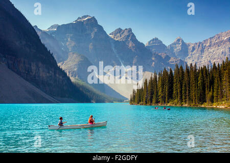 tourists-in-canoe-on-moraine-lake-in-the