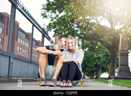 Man caressing woman in a charming way, big city couple - Stock-Bilder